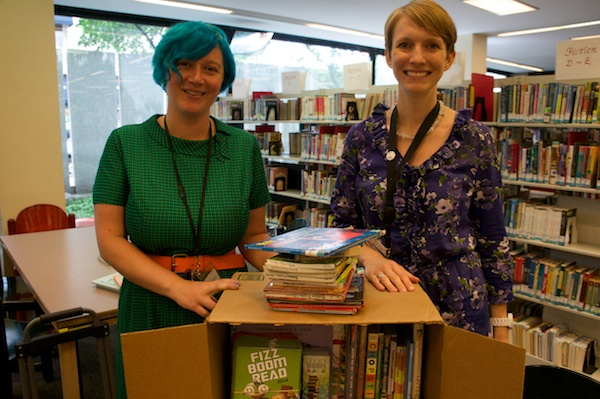 BPL Librarians with books chosen for the Boston Uni on the Greenway.