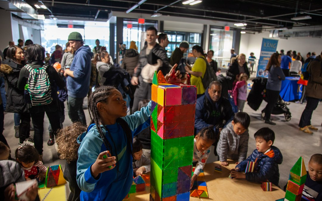 Building together at a Brooklyn indoor block party