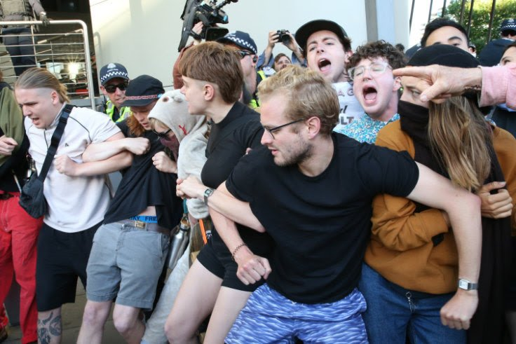 the organisers of the IMARC riots included Kim Stern (front) and Elliot Downes (light blue shirt, glasses)