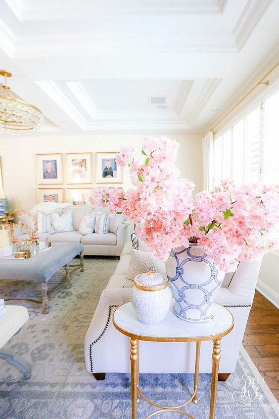 8. Blossom Flowers with light colored furniture with hint of blue