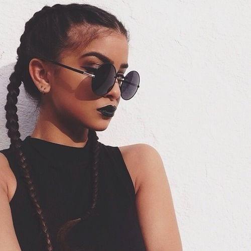 dutch braid pigtails with black sunglasses
