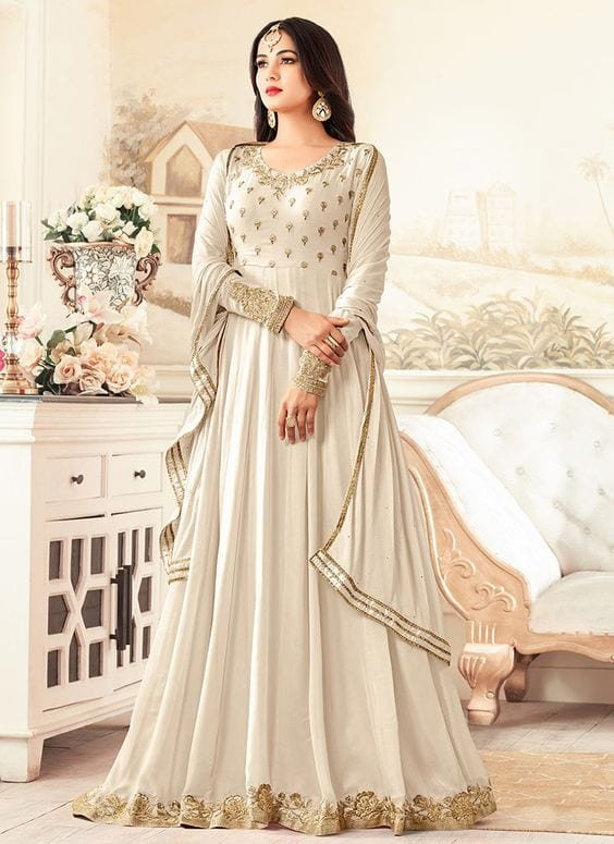 beautiful white anarkali dress with long earrings