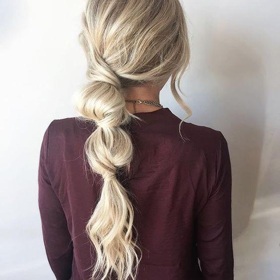 messy three poufed ponytail