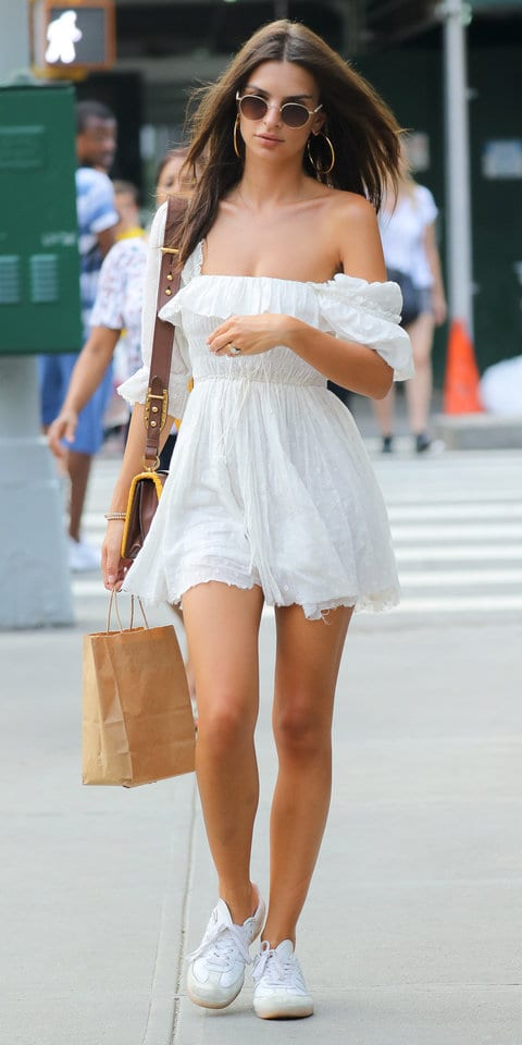 Emily Ratajkowski wears a white mini dress while walking around in New York City