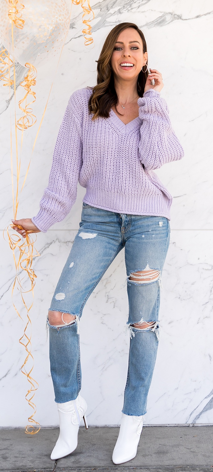 Beautiful Lavender Pull Over Teamed With Ripped Skin fit Denim Jeans and boots
