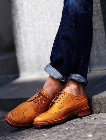 tan leather shoes paired with denims