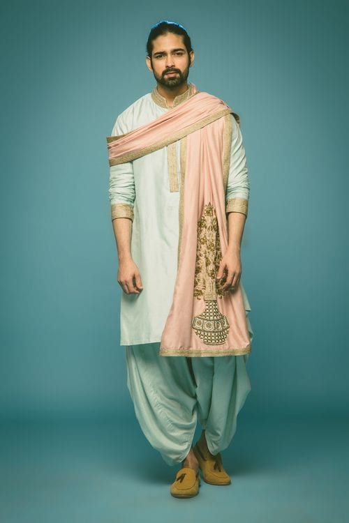 light blue kurta and dhoti styled with pink dupatta