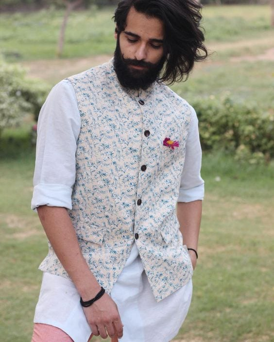 white kurta paired with nehru jacket