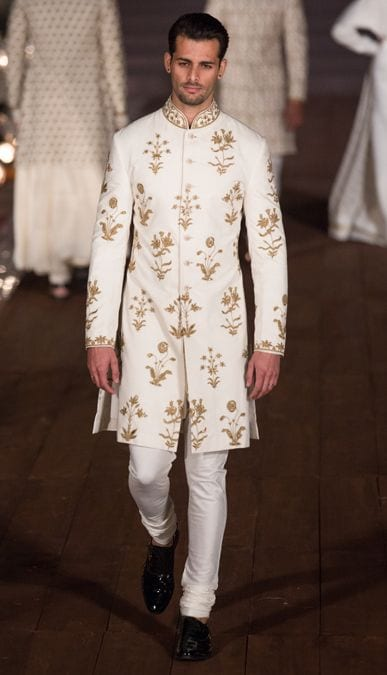 golden embroidery sherwani with plain pajama and black shoes