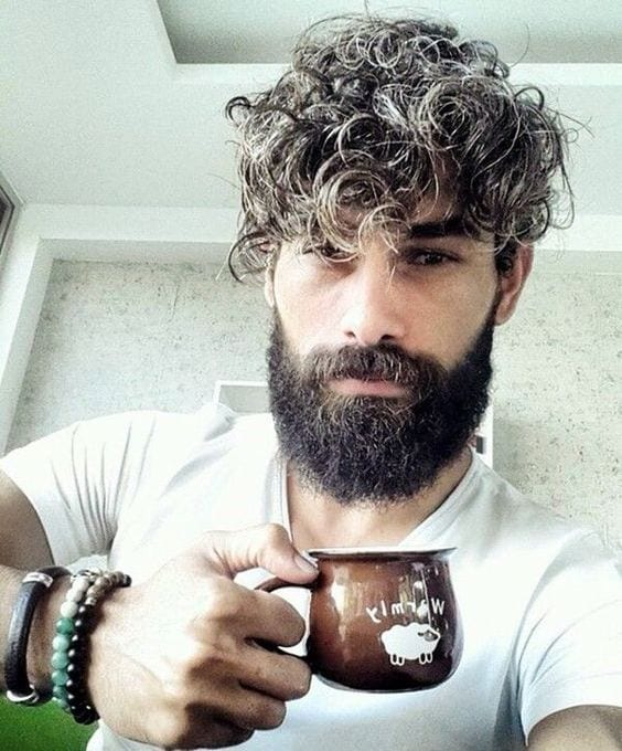 long beard and curly hairstyle