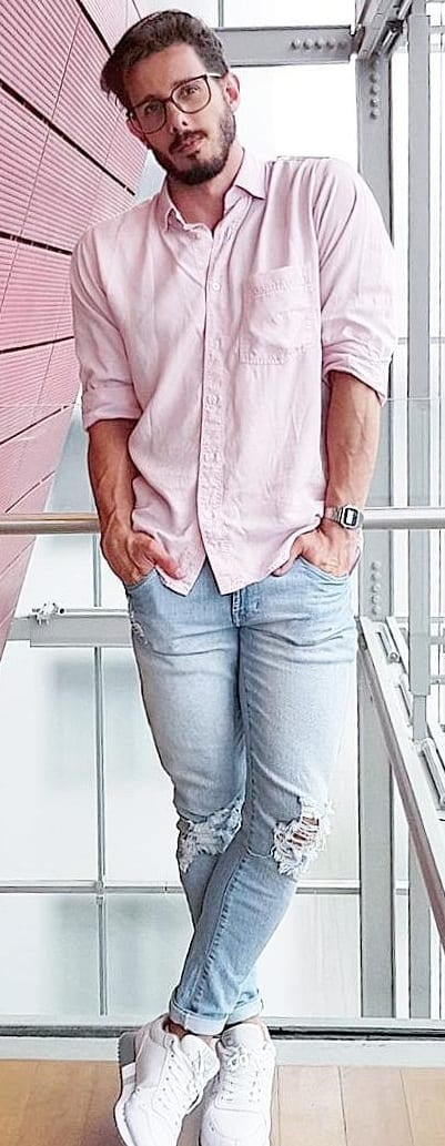blue ripped denim with pink shirt