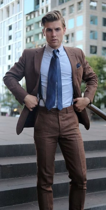 brown suit with light blue shirt and suspender