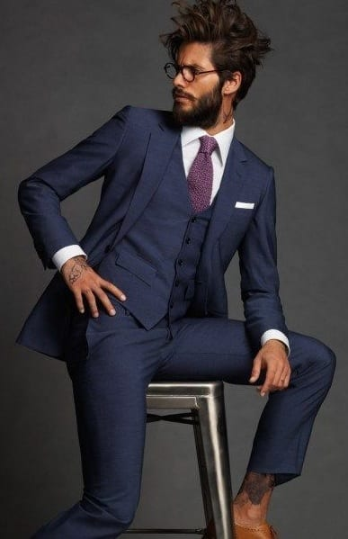 navy blue suit, messy hair