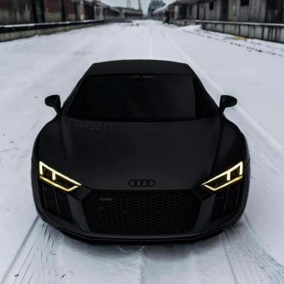 BLACK AUDI IN SNOW