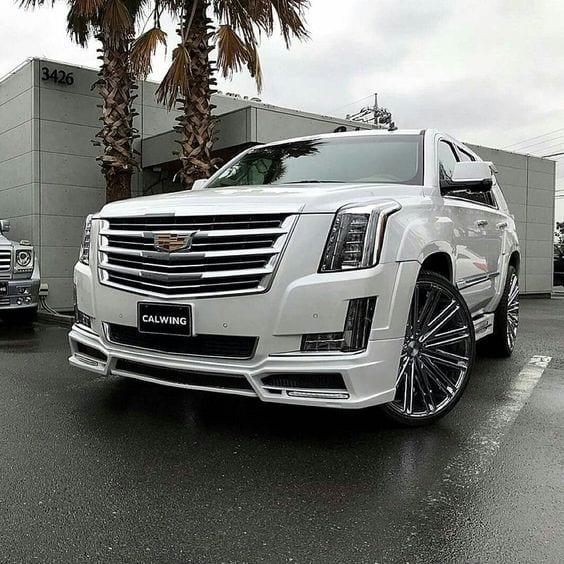 WHITE CHROME CADILLAC SUV