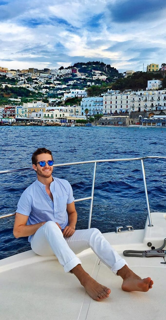 Blue linen shirt and white pant with sunglasses