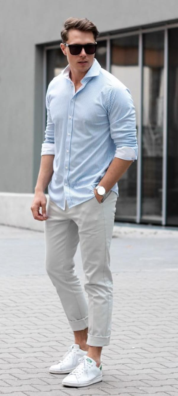 Blue shirt white sneakers and sunglasses