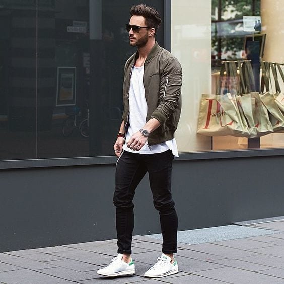 Olive-Bomber-jacket-styled-with-White-T-shirt-Black-Jeans-and-a-pair-of-White-Low-Top-Sneakers-1