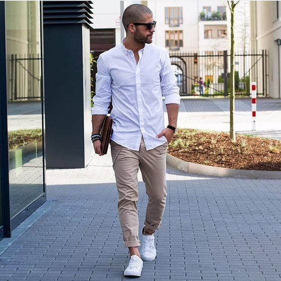 White-Sneakers-styled-with-White-Long-Sleeve-Shirt-Beige-Chinos-and-Dark-Brown-Leather-Zip-Pouch-1