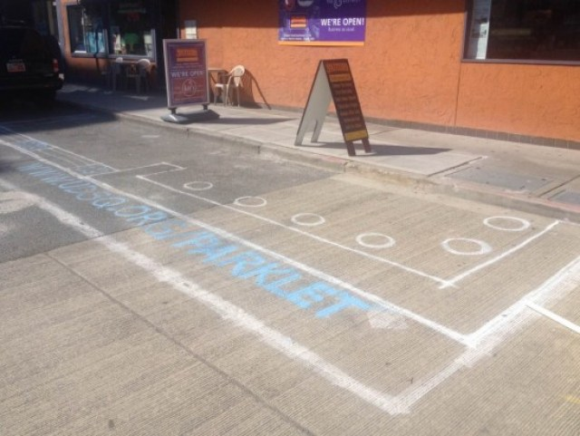 Future U District Parklet site spray painted on the ground.