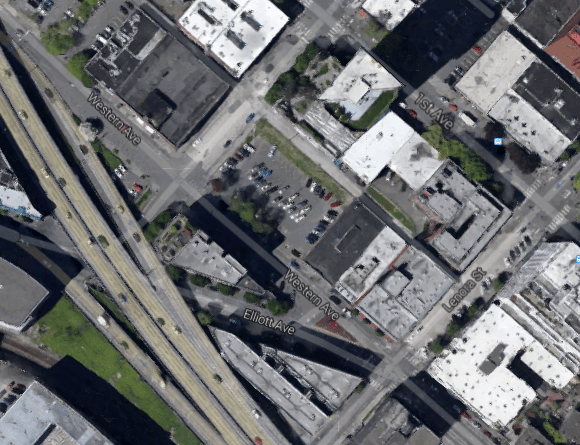 The parking lot on Western Ave is the development site, courtesy of Google Maps.