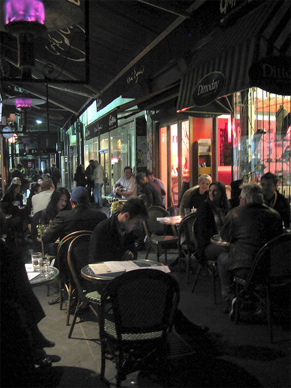 Into the evening, Block Place in Melbourne, is bustling with people sitting at one of the cafes spilling into the laneway, with musicians enhancing the ambience.