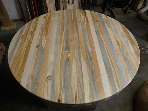 Some woodworkers and furniture makers are specializing in beetle kill pine and showing its aesthetic appeal. CLT could capitalize on the rustic appeal and put to good use the glut of beetle kill pine on a larger scale. (Custom Made)