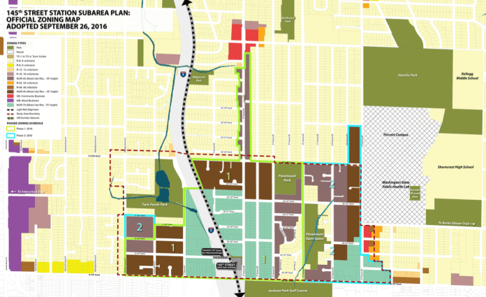 Zoning map showing a cluster of multifamily in a sea of canary yellow single family zoning.