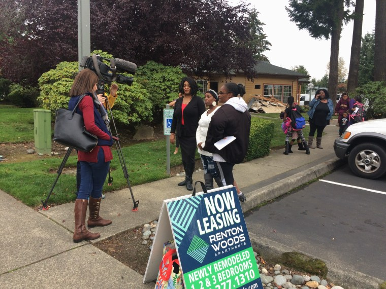 Renton families speak with media about displacement.