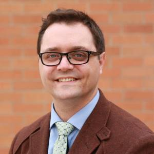 Jon Grant will again challenge Councilmember Tim Burgess.