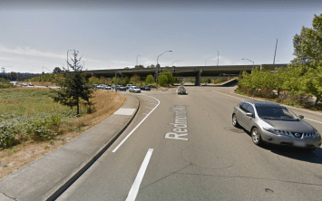 Looking westward on Redmond Way toward the SR-520 interchange; the vehicles queuing on the left side are coming from the highway off-ramp. (Google Maps)