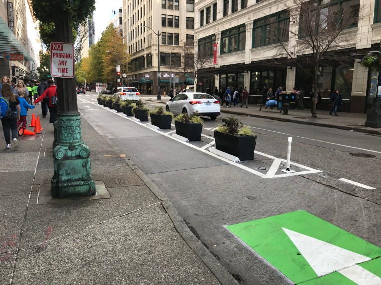 Planter boxes providing separation on Pike Street.