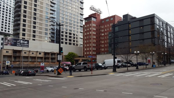 One of the last large parking lots in Downtown at 8th and Pine will soon be redeveloped with a 55-story apartment and hotel tower. (Photo by author)