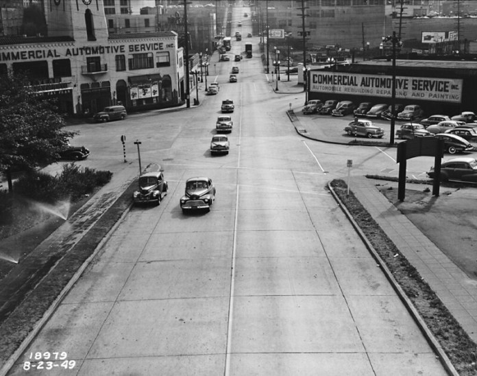 Denny Way in 1949. The $10 million investment in adaptive signals along Denny continue the legacy in relying on the street to be car-oriented above all else. (City archives)