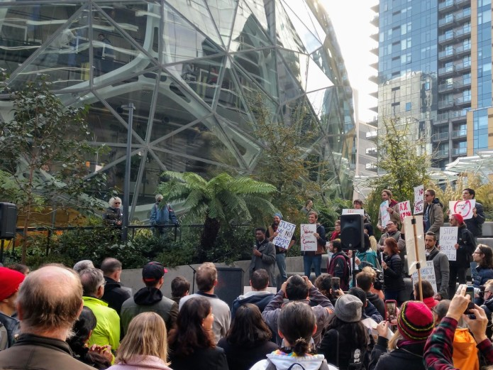 Shaun Scott addresses the crowd at the progressive rally at the Amazon Spheres the week after the company dropped another million in the race. (Photo by author)