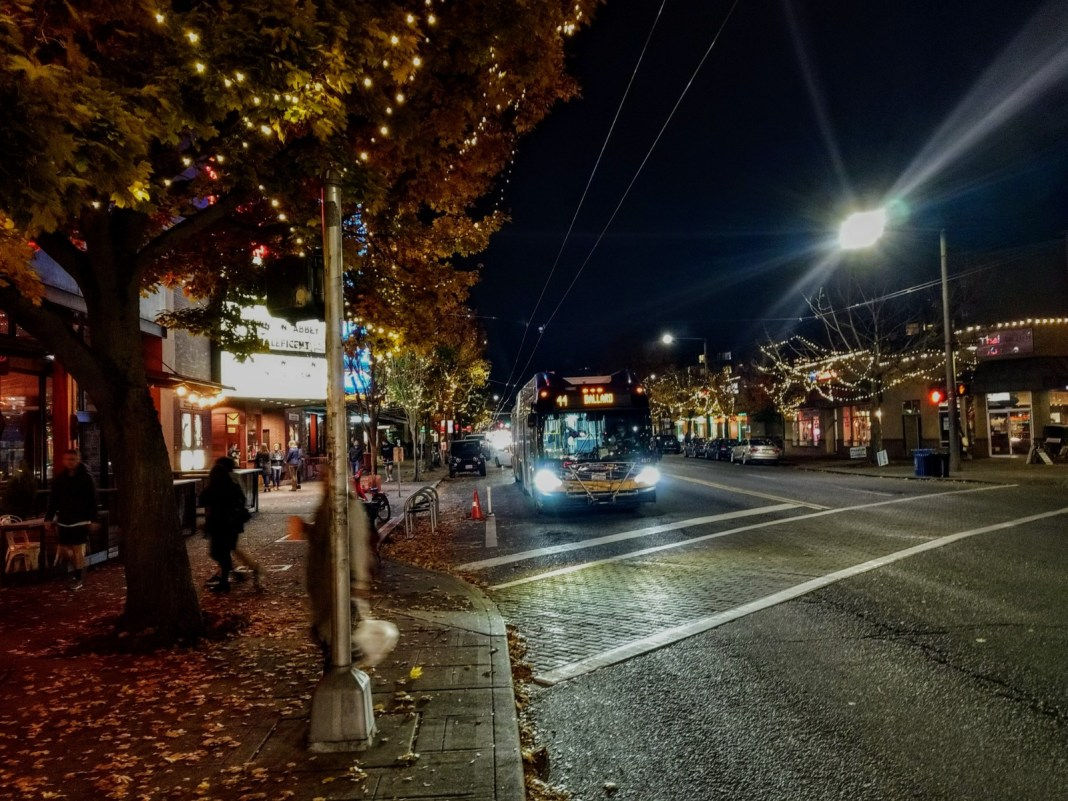 Route 44 heads through downtown Ballard on Market Street on a fall evening. (Photo by Doug Trumm))