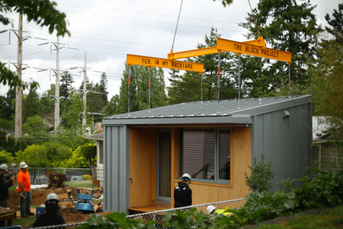 Volunteers work to install a BLOCK Project tiny house in Rainier Valley. (Credit: BLOCK Project)