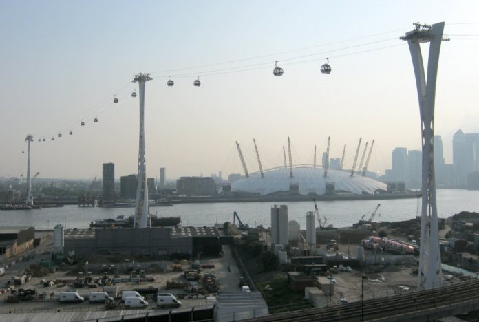 The towers of London's Emirates Air Line gondola lift cable car, from the north bank of the River Thames. (Credit: Nick Cooper via Wikimedia Commons)