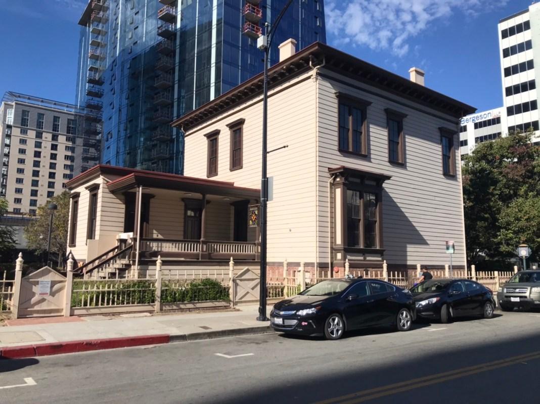 Historic Thomas Fallon House juxtaposed by new highrise San Jose.