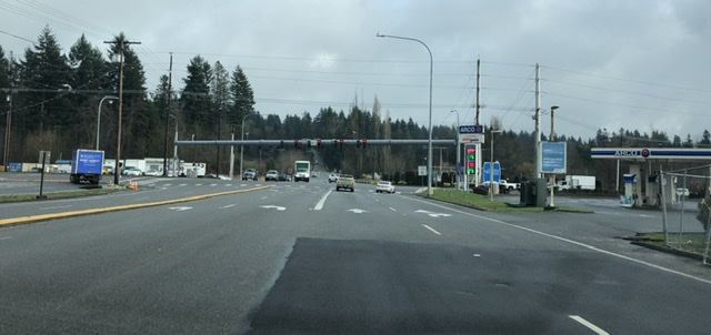 Photograph of an intersection between six lane roads. Really, it's mostly asphalt and gas stations.
