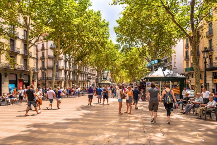 La Rambla in Barcelona offers the look and feel of a car free street surrounded by dense urban housing. Streets like these would make up the entire neighborhood and work around existing trees (image source: Hotel Casa Del Sol)