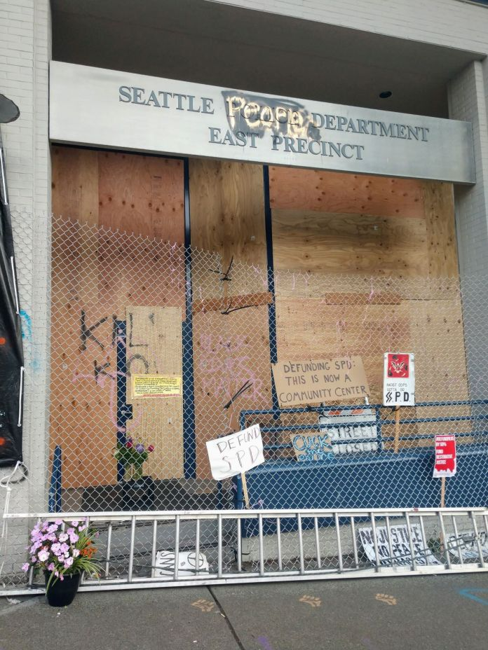"Sign outside Seattle People's Department reads ""Defunding SPD: This is now a community center."" (Photo by Doug Trumm)"