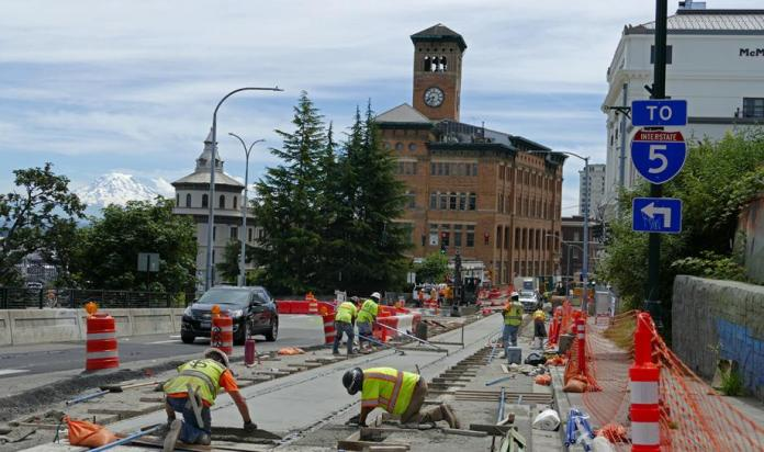 Trackbed installation for the streetcar on S Stadium Way. (Sound Transit)
