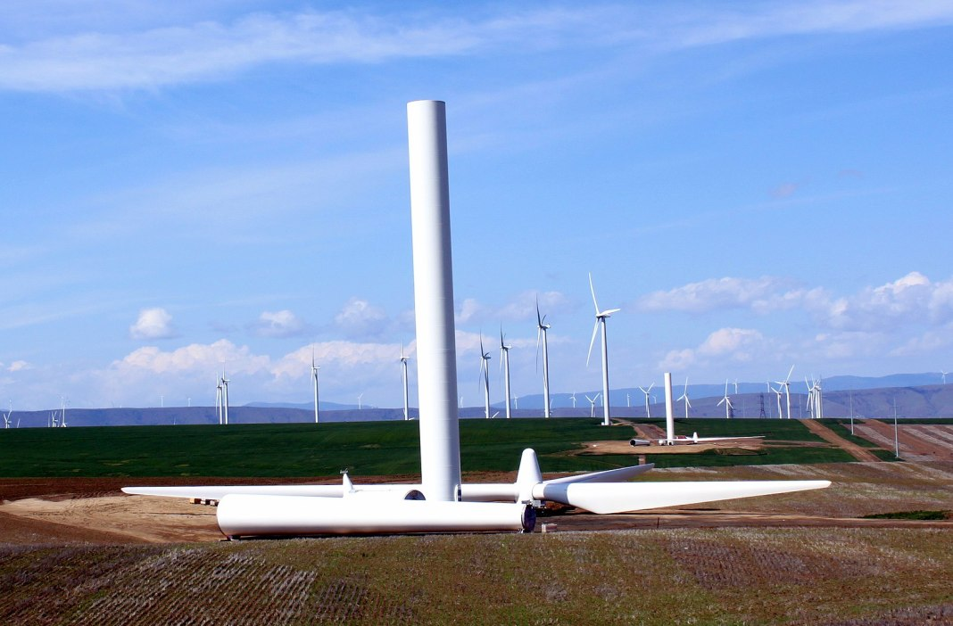 Wind turbines with one half-constructed turbine in the foreground.