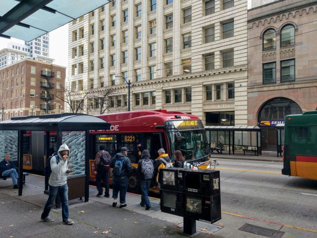 Riders board the RapidRide E, which gets a big boost from the STBD, on Third Avenue in Downtown Seattle. (Photo by Doug Trumm)