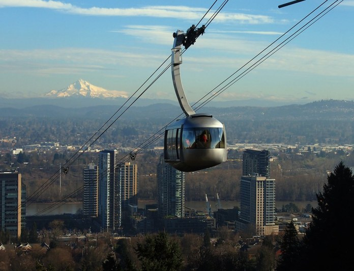 Mount Hood is in the background and the Portland aerial tram the foreground.