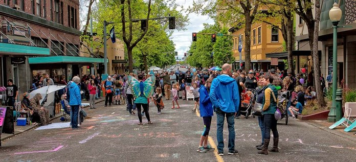 People throng the street closed for a festival.