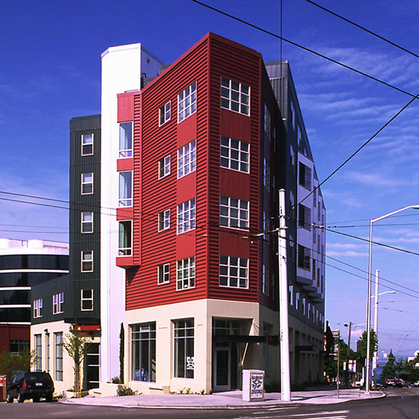 A five story building with red siding.