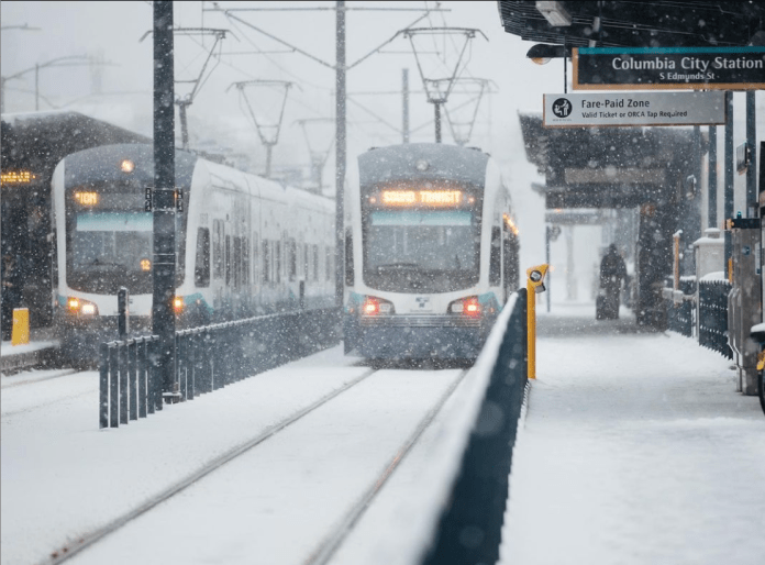 Two Link trains at Columbia City Station in the February snow.