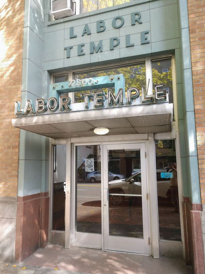 The main entrance to the Seattle Labor Temple includes Art Deco awning and detailing.